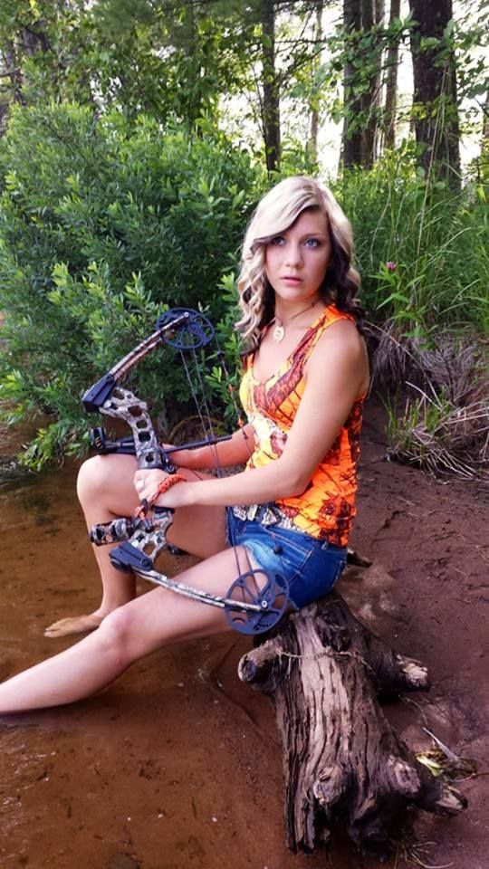 Country girl bow hunter senior portrait idea in water in ...