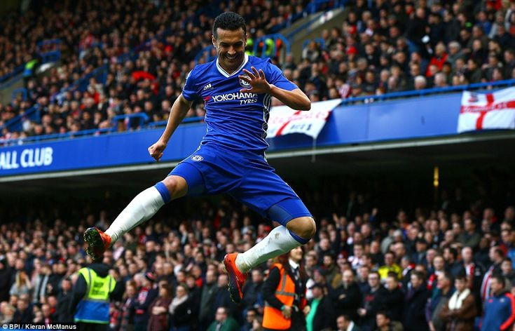 Pedro celebrates in front of the travelling Brentford supporters after doubling Chelsea's lead after 21 minutes