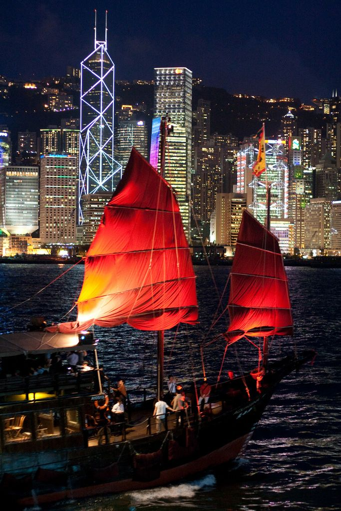 "A traditional Chinese ""junk"" plys the waters of  Victoria Harbour in Hong Kong"
