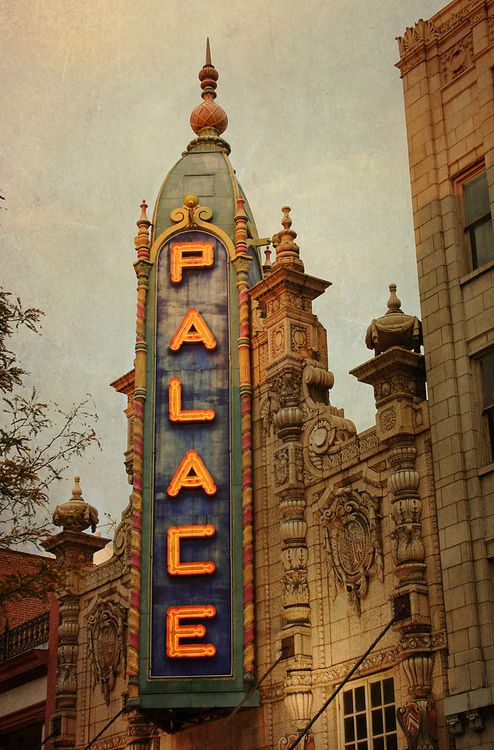 The Louisville Palace is a theatre, in downtown Louisville KY. The historic landmark opened in 1928 and was designed by architect John Eberson. Elegant and ornate, The Palace exhibits a Spanish Baroque motif with arcades, balconies and turrets. Cobalt blue, bursts of red and gold indirectly light all of the niches, coves and entrances. Above is a curved, vaulted ceiling with 139 sculptures of the faces of historical figures. The theater room inside The Palace is heavily ornamented.