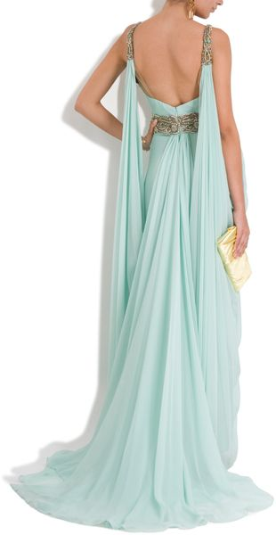 I like the beading going to the fabric drape...  Marchesa Chiffon Embellished Grecian Gown in Blue (mint) - Lyst