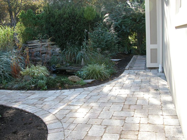 BCH Landscaping  - Interlocking stone walkway extended by stepping stones installed on river rocks