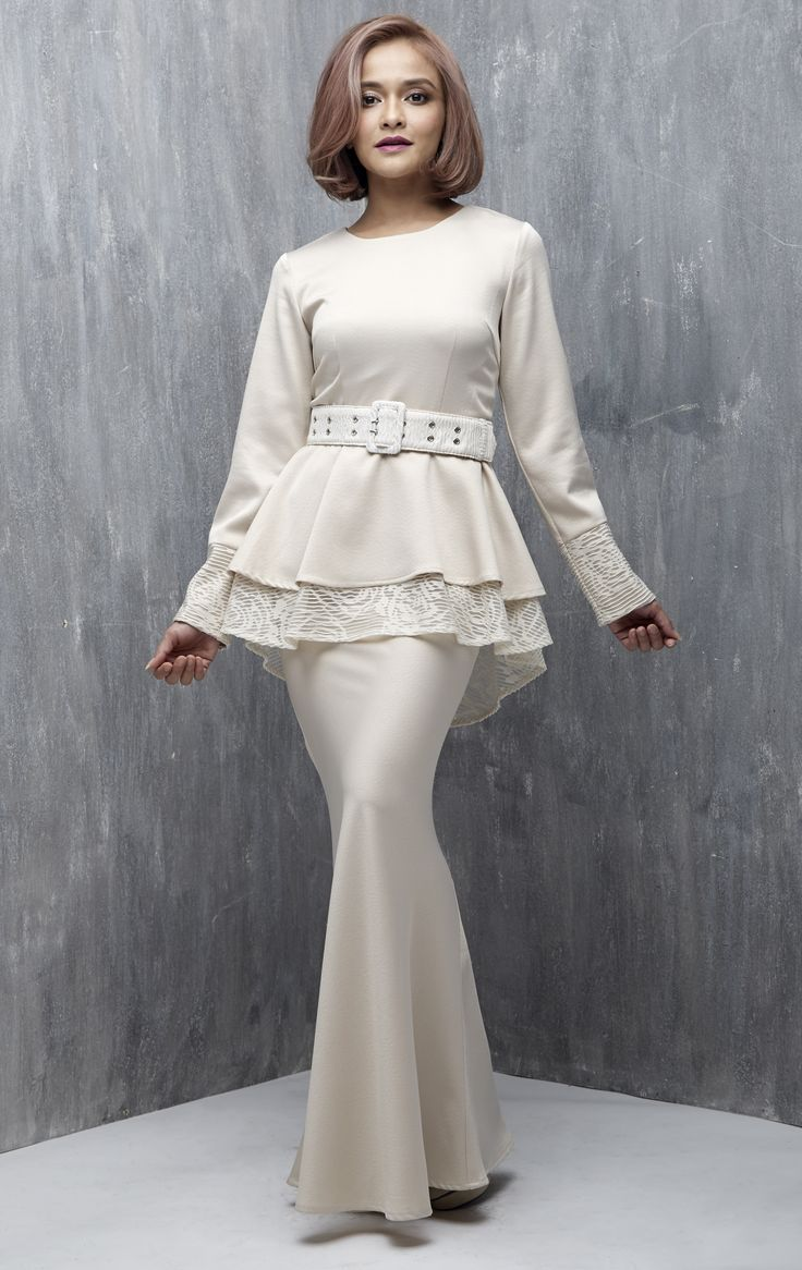 EMEL X SAZZY FALAK - ROYAL STAR - Modern Peplum with Textured Lace (Nude) This peplum design is simple yet sophisticated, featuring textured lace on the peplum and sleeves as well as on the belt for a demure and feminine look. Adjustable belt included with purchase (removable). #emelxCLPTS #emelxSazzyFalak #emelbymelindalooi #bajuraya #bajukurung #emel2016 #raya2016 #SazzyFalak #peplum #lace #nude #moden #2016 #baju #kurung #baju #raya