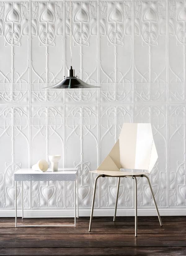 Pressed tin or wallpaper? Regardless, its a great effect ...