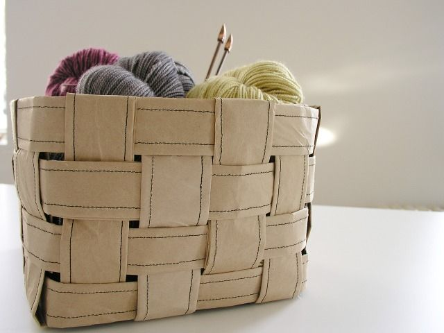 woven basket made out of packing paper...GENIUS!