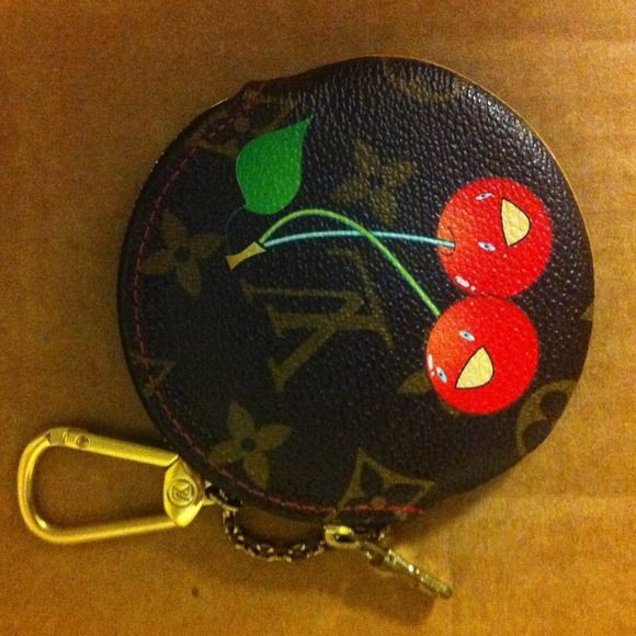 Louis Vuitton Murakami cherries cerises coin purse not sure I'm willing to let this one go yet. Purchased at a reputable consignment & authenticated by helpful ladies at the purse forum.  Limited edition cherries coin purse. Made in France. coated canvas is in great shape as are the cherries design (a few v small spots where design has worn thin). leather edge shows patina and some wear. Keychain Clip in good condition.  Chain & zipper tab show significant wear and scratching and chipping to…