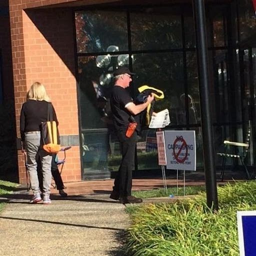 Man in Trump shirt with gun outside Virginia polling place. That's fine, as long as pulling it out of its holster is the last thing he ever does.