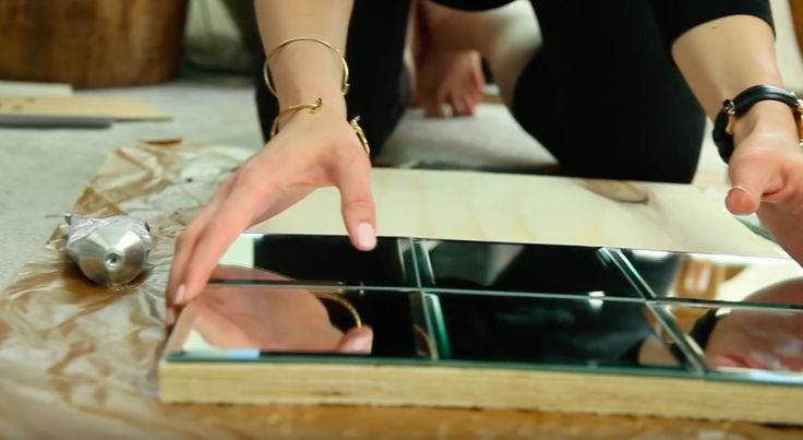 She Is Gluing Mirrors From The Dollar Store Onto Plywood To Make A Gorgeous $300 Pottery Barn Item! - http://www.wisediy.com/she-is-gluing-mirrors-from-the-dollar-store-onto-plywood-to-make-a-gorgeous-300-pottery-barn-item/