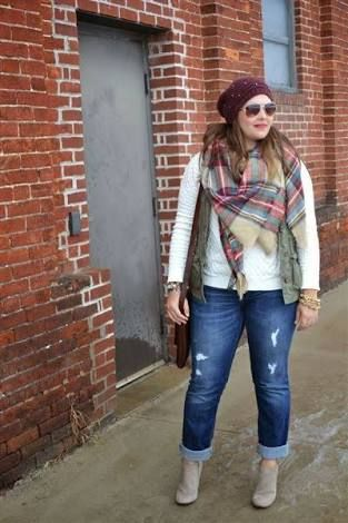 A square shaped scarf creates handkerchief folds at the front giving interest through pattern and colour as well as detracting from the torso. Skinny jeans and a vest over a fitted top creates clever layers, the hair style with beanie completes the casual style.  Photo credit- Pinterest