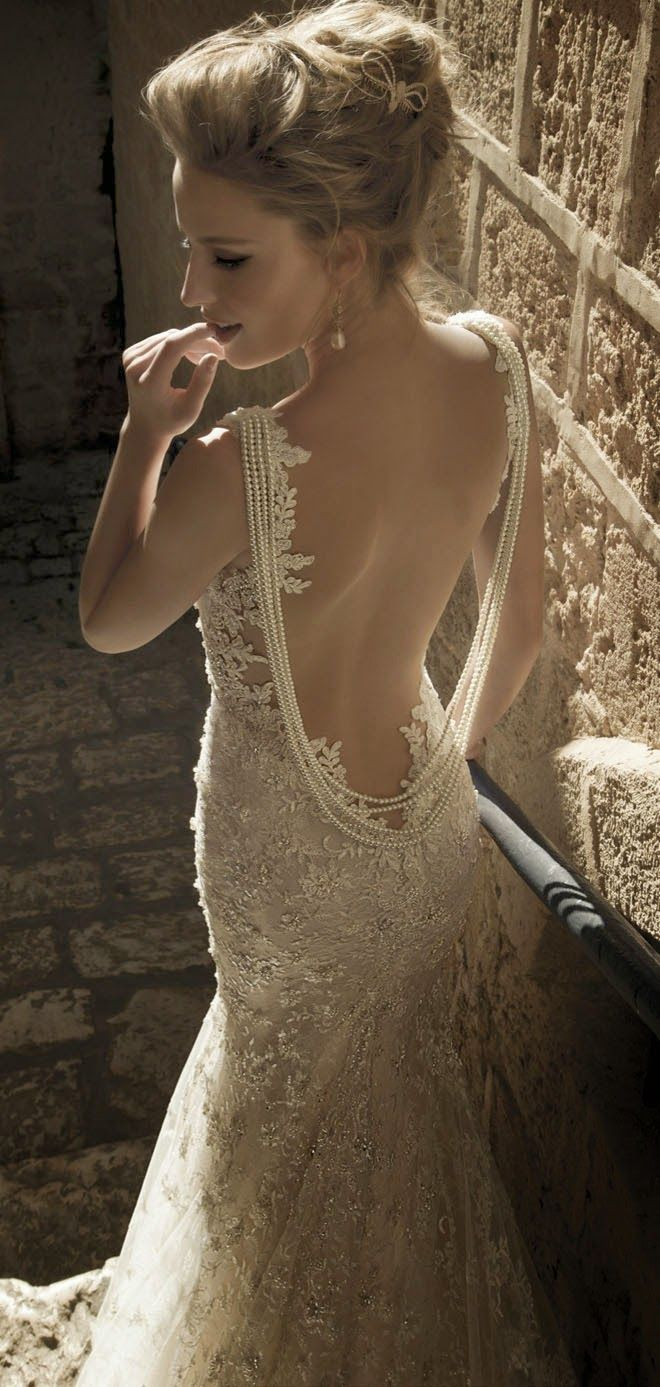 I am not usually looking at the wedding dresses, but if I were to have one for myself again, this would definitely be the one. I cannot express just how absolutely mesmerizing this dress is. I love the bead and lace work. The pinnacle is the pearls draping down the sides of the open back. Oh my gosh, I love this dress !!!!!: