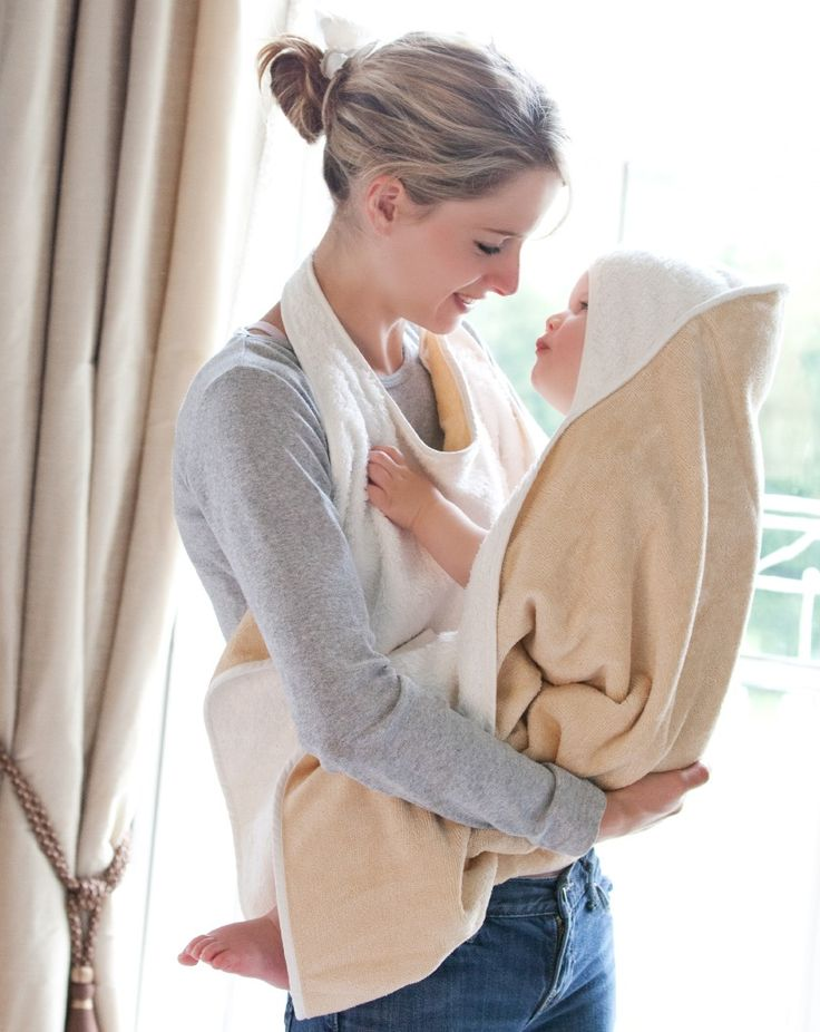 The Cuddledry towel has an apron style to keep your hands free to lift a slippery baby out of the water
