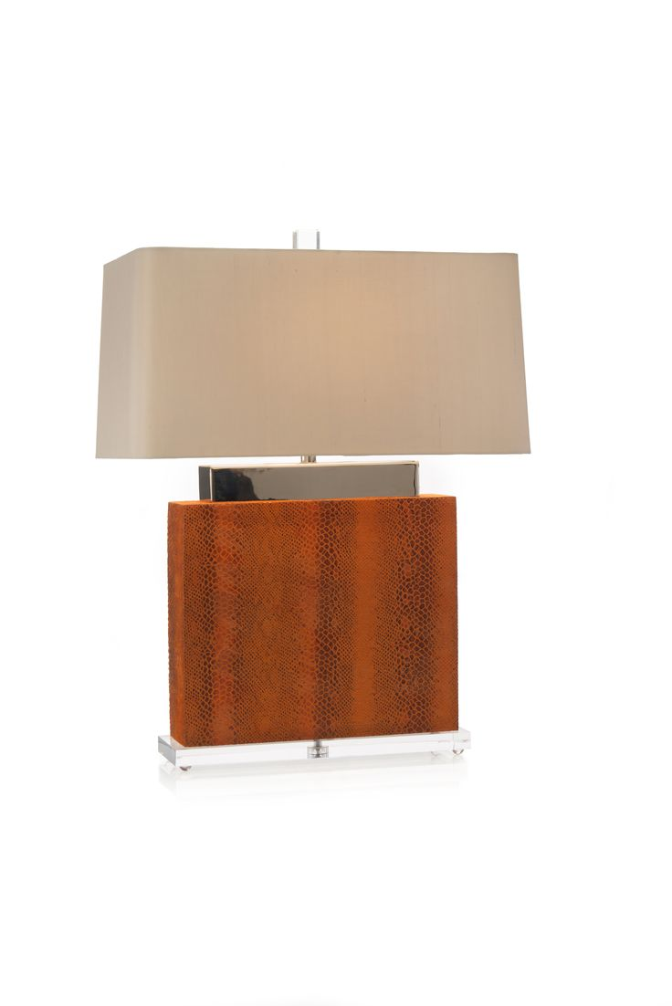 "This transitional lamp from John Richard is right on trend with fashion & interiors! Orange faux snakeskin monolithic lamp mounted on a footed acrylic base with nickel plated pediment""  30"" high -  shade in oyster linen ( 21 x 13) x (22 x 14) x 11. 200 Steele #hpmkt #stylespotter"