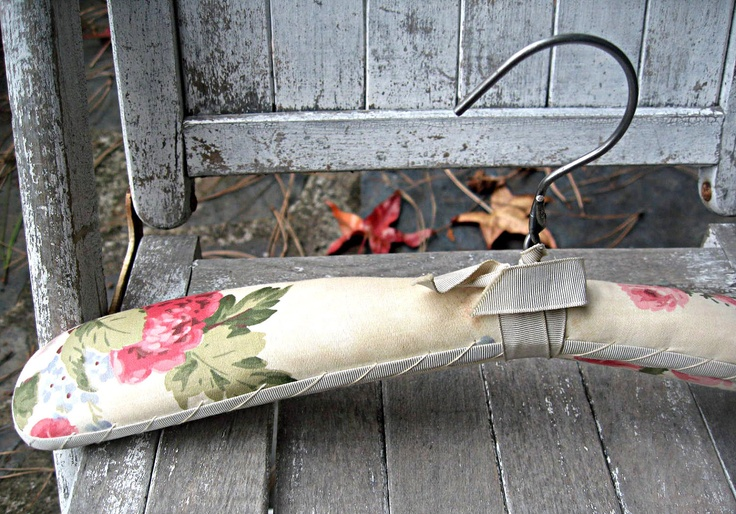 Vintage floral padded clothes hanger, stunning fabric with satin trim, boudoir hanger, clothing display. $21.00, via Etsy.