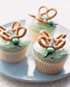 Butterfly Cupcakes - Martha Stewart Food-dip the pretzels in melted almond bark dyed in a pastel color.