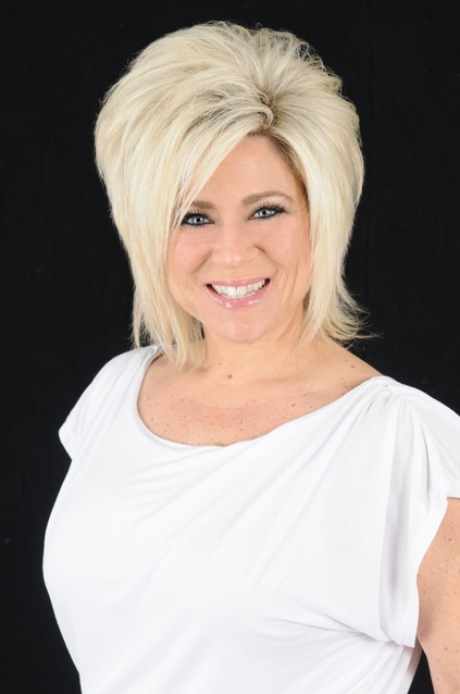 Theresa Caputo - Long Island Medium. It's on my bucket list to meet this woman. Not for a reading, tho that would be nice. Simply because she seems so nice, compassionate and a real down to Earth person.