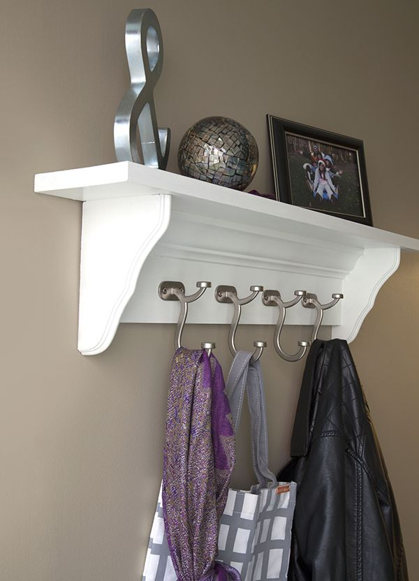 Easy DIY project: Make a decorative coat hook rail using crown moulding, corbels and designer hooks. It's great for an entryway, mud room or any place you want a place to hang your coat. We have the step-by-step tutorial on The Home Depot Blog.