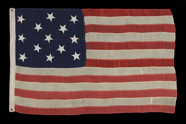 13 HAND-SEWN STARS ON AN ANTIQUE AMERICAN FLAG OF THE 1876 ERA, PROBABLY A U.S. NAVY SMALL BOAT ENSIGN