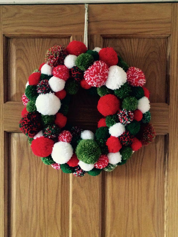Pom Pom Christmas wreath made by me (JoMoore) 130 pom poms on a polystyrene ring.