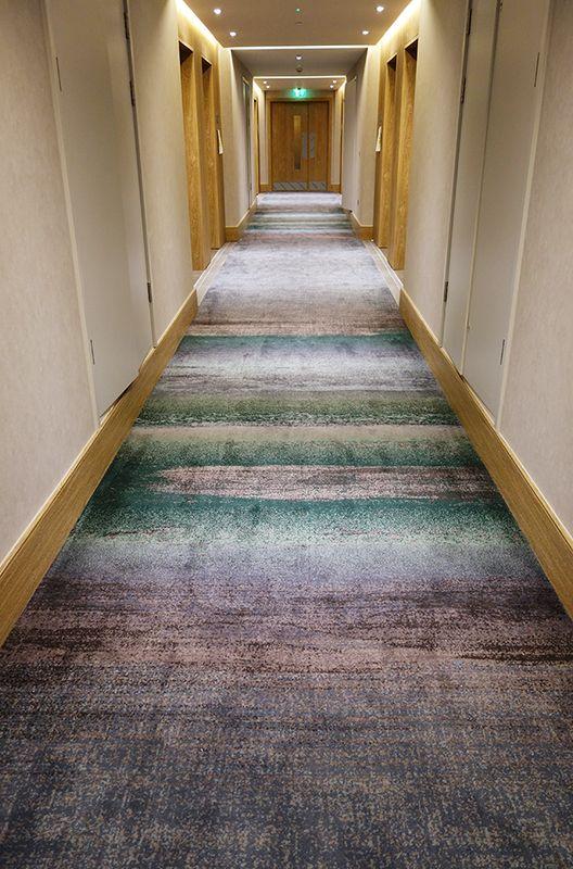 watercolour inspired carpet limed timber concrete effect wall covering industrial refined interior design londonhotel