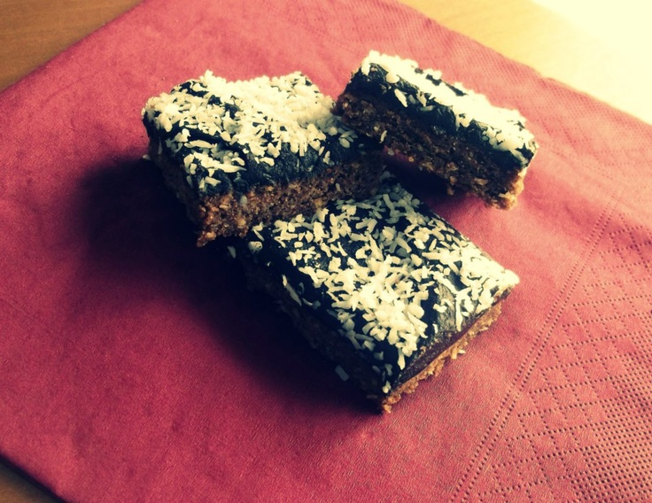 chocolate coconut slice - topped with chocolate icing & sprinkled with coconut