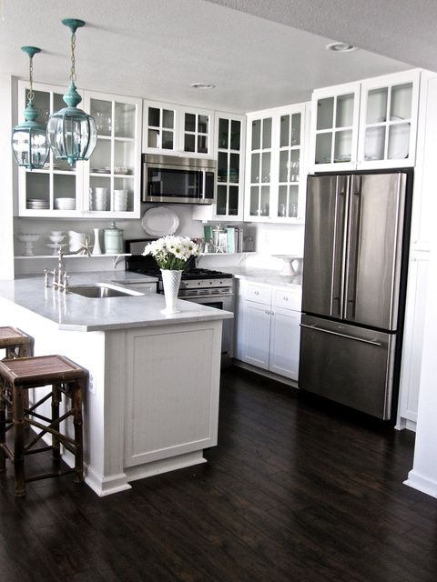 lovely white kitchen with a pop of turquoise. white glass-front kitchen  cabinets with - Best 25+ Dark Wood Floors Ideas Only On Pinterest Dark Flooring