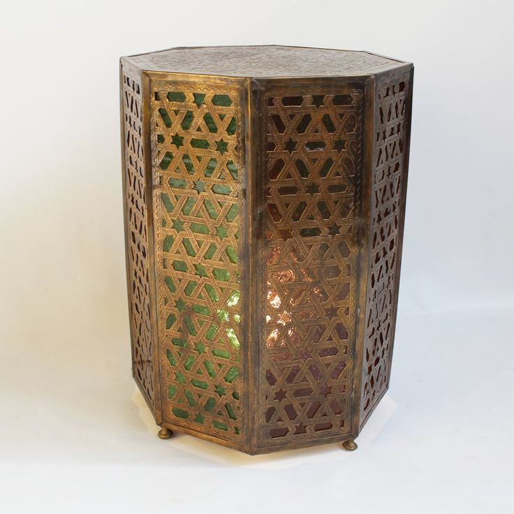 Shop our tables at Mix Furniture!! Hand cut brass work octagonal shaped side table with multi colored glass inlay light fixture gives off a beautiful glow.