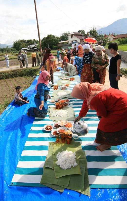 Makan bajamba, or eating together is a traditional custom that unites the Minangkabau's community. The women prepare t...