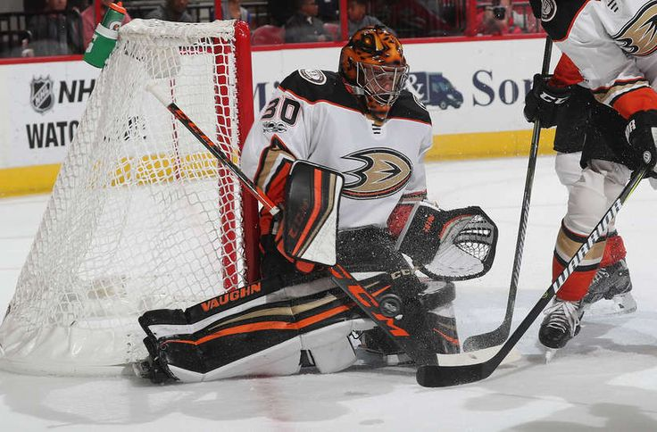 Ryan Miller #30 of the Anaheim Ducks goes down in the crease to deflect the puck away from the net during an NHL game against the Carolina Hurricanes on October 29, 2017 at PNC Arena in Raleigh, North Carolina.