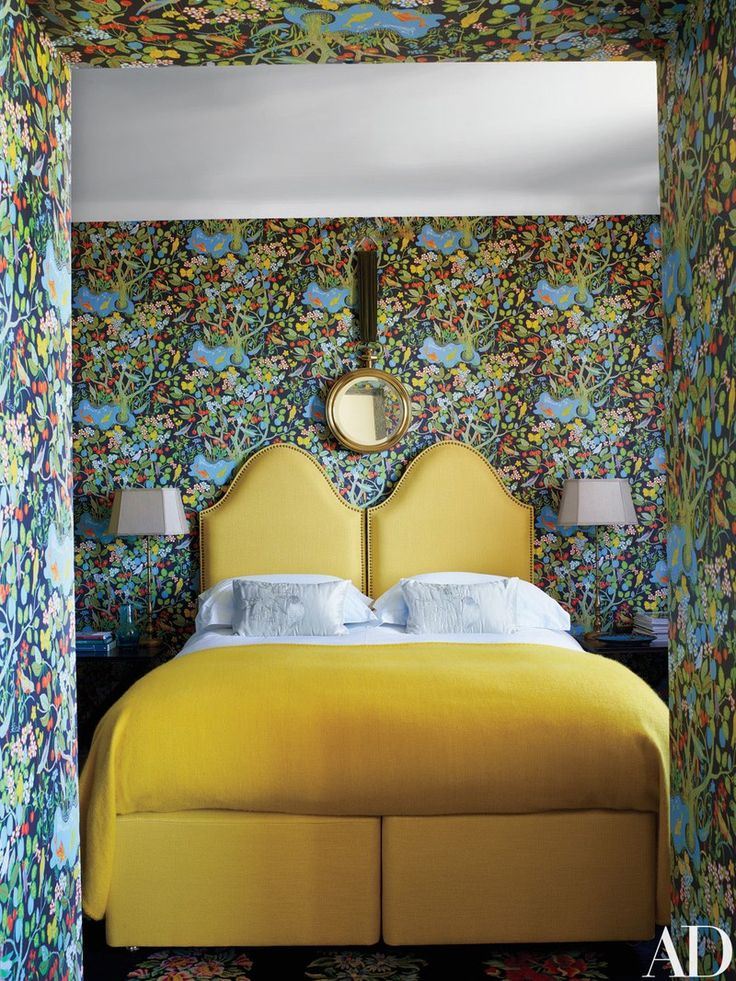 A Josef Frank wallpaper from Svenskt Tenn transforms a bedroom into a garden. Beaudesert beds.