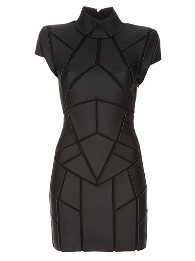 Black leather look dress from Gareth Pugh featuring panels of geometric shaped leather look fabric, funnel neck, structured shoulders, with a tight fit.