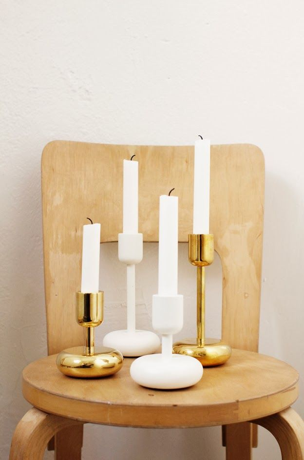 Iittala Christmas Home. Iittala + Varpunen collaboration. Nappula white and brass candleholders.