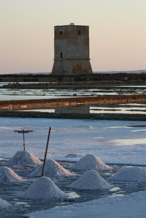 #Sunset at #Trapani #salt pans with salt harvesting www.bebtrapaniganveliero.it