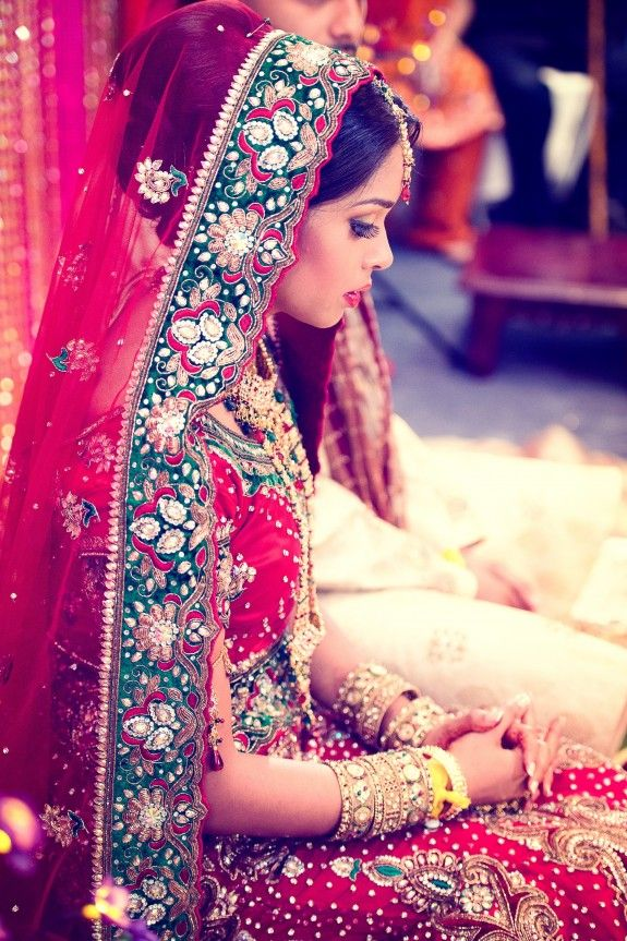 Beautiful Indian Bride in a red lengha with an embellished chunni (scarf).
