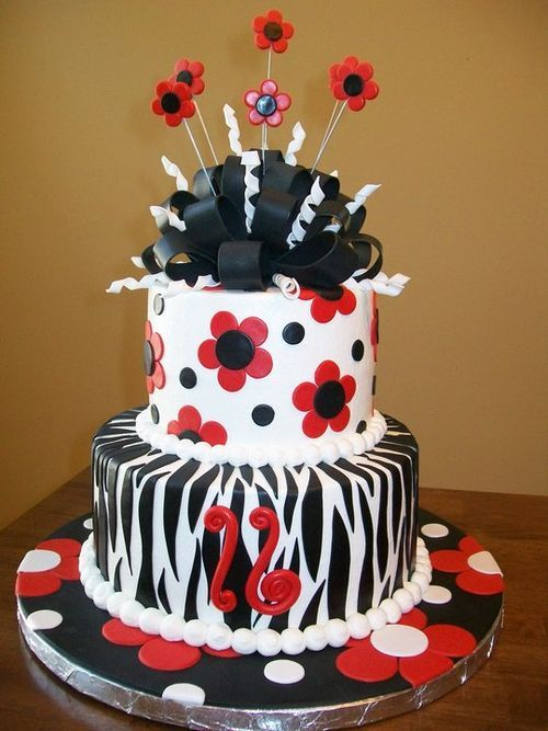 red, white, and black 2-tier cake with zebra print and flowers