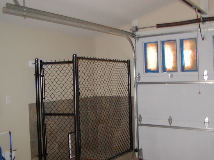 Garage kennel with door to outside kennel