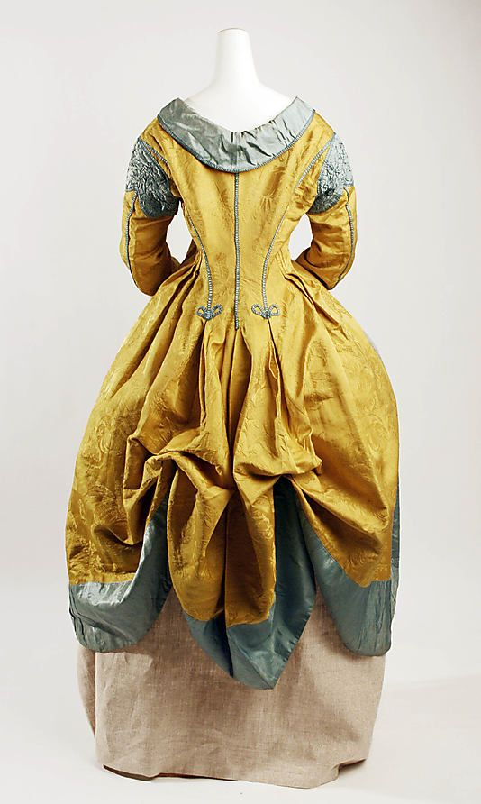 The Met, Robe a la Polonaise, 1787:  This popular style was named for the division of Poland into three parts in 1772, symbolized by the three portions of the skirt, when drawn up.  The Robe a la Polonaise also features a cutaway bodice styled like a man's frock coat, and worn over a gilet, or vest.  There is no waist seam, and the bodice hangs loosely from the center front. The Robe a la Polonaise was in fashion in the 1770s and 1780s.
