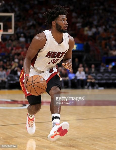 News Photo : Justise Winslow of the Miami Heat brings the ball...