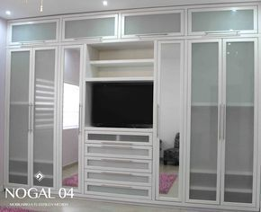 Closet para Recámara de Niñas: Vestidores y closets de estilo moderno por Nogal 04