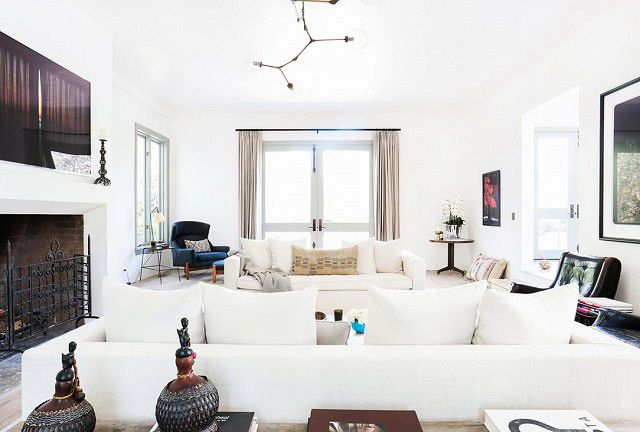 "While it may be tempting to push a sofa against a wall facing a media stand and call it a day, Roberts reminds us that there is more involved in planning a great living room layout. ""It's..."