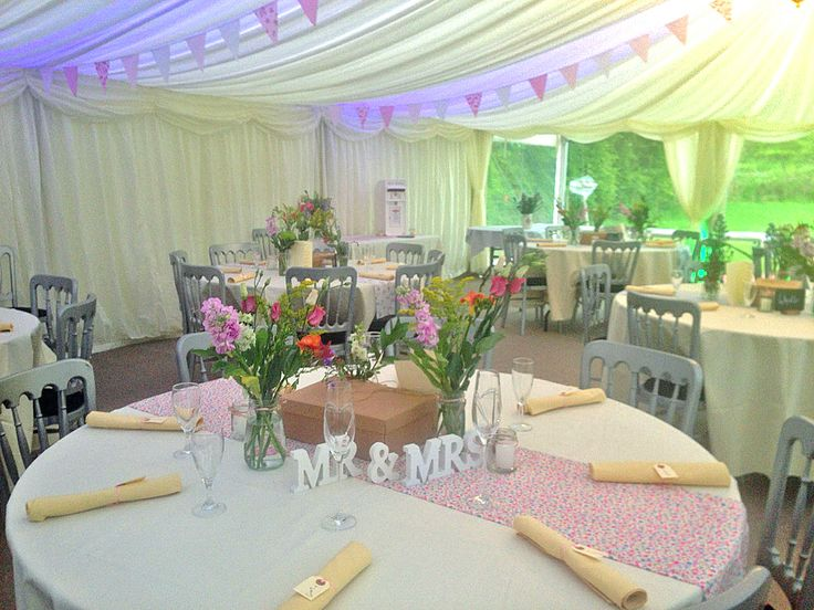 Colour wash lighting & bunting sets off this wedding marquee by www.24carrotevents.co.uk