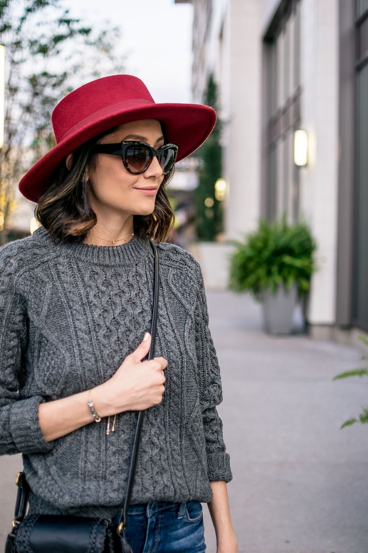 Red hat & grey cable knit sweater