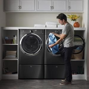 4.3 Cu. Ft. Front Load Washer with 8.0 Cu. Ft. Electric Front Load Dryer and Pedestals | Nebraska Furniture Mart
