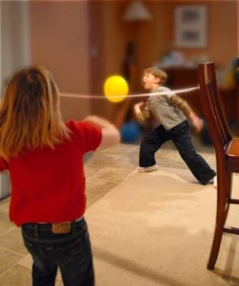 For when kids can't go outside: Volley ball with balloon and crepe paper streamer as the net. Fun for the whole family!