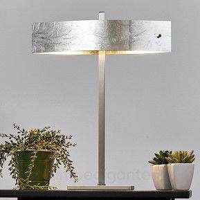 Både teknologien og materialene som er brukt i denne bordlampen holder den beste kvalitet.
