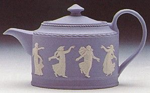Dancing Hours Wedgwood teapot. Wedgwood Jasperware is a type of stoneware first developed by Josiah Wedgwood, although some authorities have described it as a type of porcelain. It is noted for its matte finish and is produced in a number of different colours,of which the best known is a pale blue that has become known as 'Wedgwood Blue'.:
