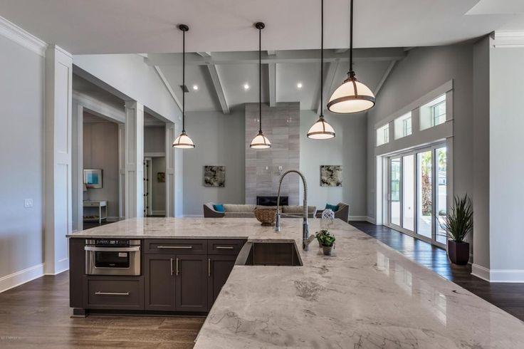 Transitional Kitchen with Complex marble counters, Brazilian Arabescato Satin, Hardwood floors, Flush, Flat panel cabinets