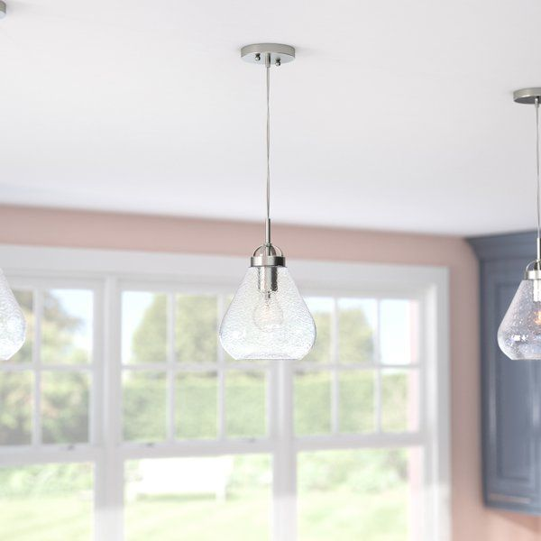 This 1 Light Mini Pendant offers a stylish brushed nickel finish which blends with traditional and transitional décor. The clear crackle glass is stunning when illuminated. Ideal for kitchens, dining room, bedroom and bathrooms. It uses one medium-base light bulb, 60-watt maximum (not included). The fixture is ETL/CETL listed for safety.
