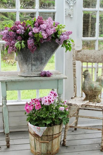 Lilacs in vintage containers