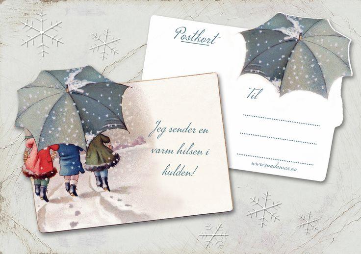 Sjarmerende kort med vintermotiv, 3 barn som går under en paraply i snøen. Tekst: Jeg sender en varm hilsen i kulden. Mål: ca 17,3 cm x 14 cm