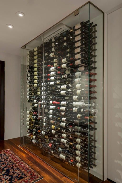 Happy Valley in Scottsdale, Arizona     |     A unique floor-to-ceiling glass wine cellar displays over 400 bottles of wine.  via @waltdanley